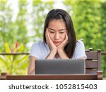asian woman working with... | Shutterstock . vector #1052815403