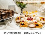 candy bar with macarons  cakes  ... | Shutterstock . vector #1052867927