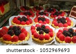 Small photo of Bursting Berry Tarts displayed in a bakery window to tempt your sweet tooth with flavored cream, flaky pastry and the tarty sweetness of the bursting berries.