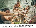 friends making fish barbecue on ... | Shutterstock . vector #1052987423