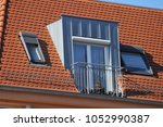 roof with standing seam metal... | Shutterstock . vector #1052990387