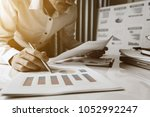 Small photo of Businessman working analysis accounting data in the office.