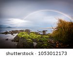 fantastic rainbow over a lake ... | Shutterstock . vector #1053012173