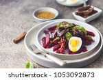 salad from boiled beet  young... | Shutterstock . vector #1053092873