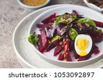 salad from boiled beet  young... | Shutterstock . vector #1053092897