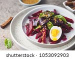 salad from boiled beet  young... | Shutterstock . vector #1053092903