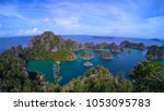 view of the piaynemo lagoon... | Shutterstock . vector #1053095783