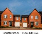 new english red brick build... | Shutterstock . vector #1053131363