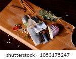 herring fillet  on a cutting... | Shutterstock . vector #1053175247