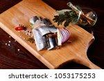 herring fillet  on a cutting... | Shutterstock . vector #1053175253