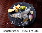 herring entirely with ginger... | Shutterstock . vector #1053175283