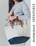 women bag on hand on grey... | Shutterstock . vector #1053191813