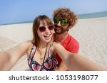 happy lovers  smiling woman and ... | Shutterstock . vector #1053198077