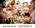 group of friends having... | Shutterstock . vector #1053283673