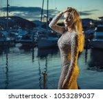 attractive blonde beauty posing ... | Shutterstock . vector #1053289037