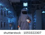 Small photo of Electrical worker wearing arc flash suit protection