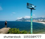 favela resident is looking at... | Shutterstock . vector #1053389777