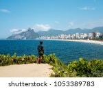 favela resident is looking at... | Shutterstock . vector #1053389783