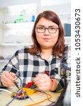 female apprentice working on... | Shutterstock . vector #1053430673