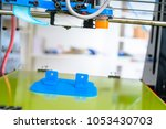 3d printer of the device during ... | Shutterstock . vector #1053430703