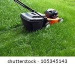 mowing a lawn with a lawn mower | Shutterstock . vector #105345143