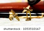 brass aircrafts cufflinks. | Shutterstock . vector #1053510167