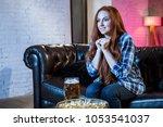 emotional woman football fan at ... | Shutterstock . vector #1053541037