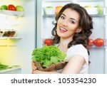 a hungry girl opens the fridge - stock photo