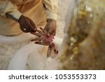 a malay bridegroom  holds his... | Shutterstock . vector #1053553373