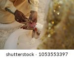 a malay bridegroom  holds his... | Shutterstock . vector #1053553397