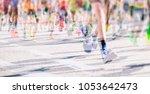marathon runners in the city    Shutterstock . vector #1053642473