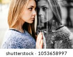 self reflection portrait of... | Shutterstock . vector #1053658997