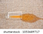 spilled juice on carpet | Shutterstock . vector #1053689717