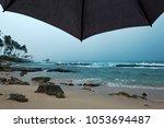 view on ocean during rain in... | Shutterstock . vector #1053694487
