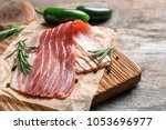 board with raw bacon on table ...   Shutterstock . vector #1053696977