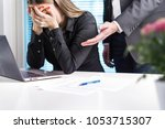 upset woman crying in office.... | Shutterstock . vector #1053715307