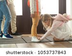 sister helping brother to tie... | Shutterstock . vector #1053737843