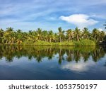 reflections of coconut trees... | Shutterstock . vector #1053750197