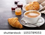 breakfast with cup of coffee... | Shutterstock . vector #1053789053