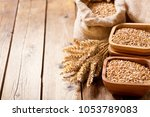grains and wheat ears on a... | Shutterstock . vector #1053789083