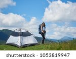 attractive girl tourist with... | Shutterstock . vector #1053819947
