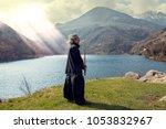 mature man practicing tai chi... | Shutterstock . vector #1053832967