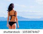 young beautiful girl in bikini... | Shutterstock . vector #1053876467