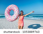 girl relaxing with donut lilo... | Shutterstock . vector #1053889763