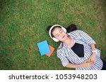 beautiful asia women student... | Shutterstock . vector #1053948203
