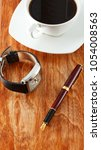 pen  coffee and clock on a... | Shutterstock . vector #1054008563