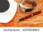 pen  coffee and clock on a... | Shutterstock . vector #1054008863