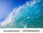 shorebreak surfing wave  ocean... | Shutterstock . vector #1054046003