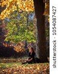 melancholic woman rests under a ...   Shutterstock . vector #1054087427