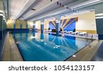 swimming pool in modern gym... | Shutterstock . vector #1054123157